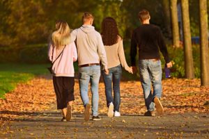 two couples walking down a path